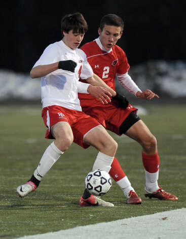 Farifield Prep's David Bigley and Greenwich's Nico Patrk compete for control of the ball during Friday's Class LL boys soccer semifinal game at New Canaan High School on November 16, 2012. Photo: Lindsay Niegelberg / Stamford Advocate