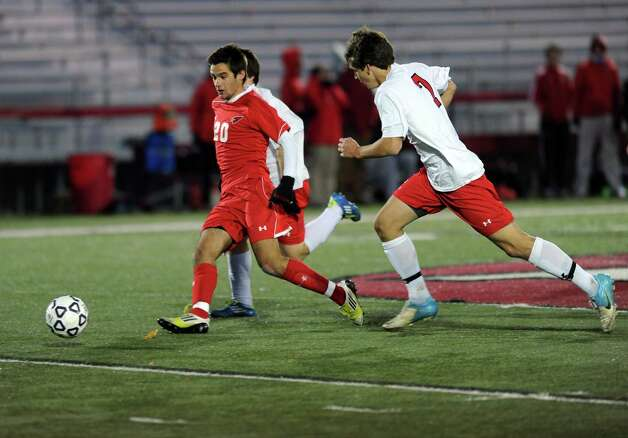 Greenwich's Mateo Gowland controls the ball during Friday's Class LL boys soccer semifinal game at New Canaan High School on November 16, 2012. Photo: Lindsay Niegelberg / Stamford Advocate