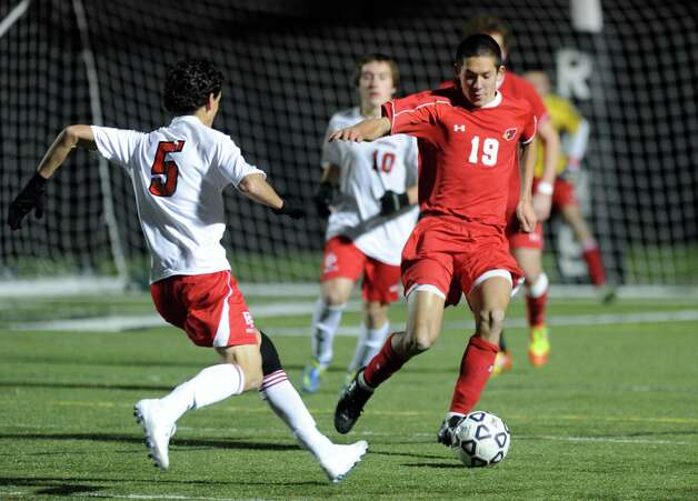 Greenwich's Pieter Zenner controls the ball during Friday's Class LL boys soccer semifinal game at New Canaan High School on November 16, 2012. Photo: Lindsay Niegelberg / Stamford Advocate