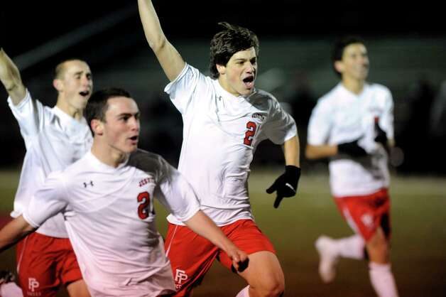Fairfield Prep players celebrate their win in a shootout during Friday's Class LL boys soccer semifinal game at New Canaan High School on November 16, 2012. Photo: Lindsay Niegelberg / Stamford Advocate