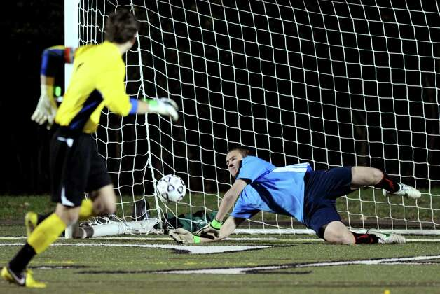 Fairfield Prep's William Steiner scores a goal against Greenwich's Santiago Irigoyen during a shootout in Friday's Class LL boys soccer semifinal game at New Canaan High School on November 16, 2012. Photo: Lindsay Niegelberg / Stamford Advocate