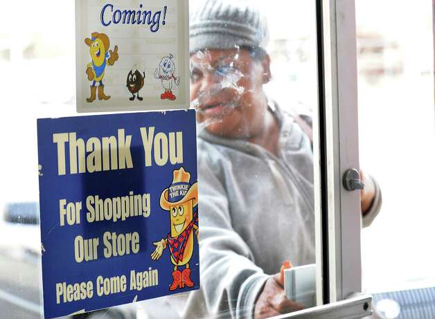 A customer enters the Wonder Bread Bakery Outlet on Wells Street in Bridgeport, Conn. on Friday, Nov. 16, 2012. Hostess Brands Inc. announced itâÄôs going out of business, meaning the loss of about 18,500 jobs. Hostess employs about 200 workers in Connecticut in non-bakery retail and distribution facilities. Photo: Cathy Zuraw / Connecticut Post