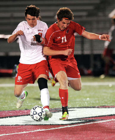 Fairfield Prep's Stephen Tortora and Greenwich's Aidan Rafferty compete for control of the ball during Friday's Class LL boys soccer semifinal game at New Canaan High School on November 16, 2012. Photo: Lindsay Niegelberg / Stamford Advocate