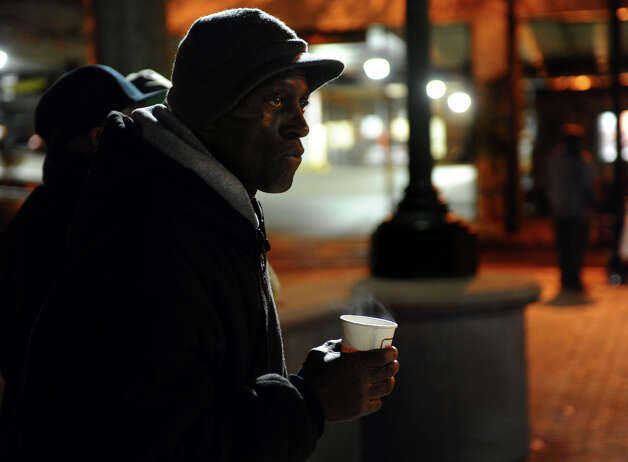 Resident Robert Milton enjoys a coffee to stay warm before the start of an event on McLevy Green to help the city's homeless and needy in downtown Bridgeport, Conn. on Friday November 16, 2012. It was hosted by A Better Bridgeport. Bread and blankets supplied by the organization Helping Hands in the Community were given out as well as donated clothing. Photo: Christian Abraham / Connecticut Post