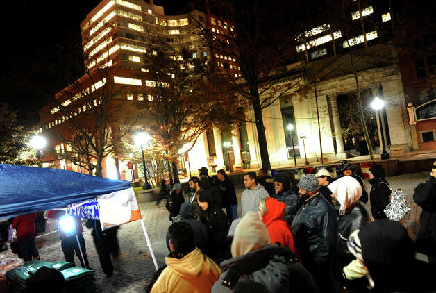 A Better Bridgeport hosted an event on McLevy Green to help the city's homeless and needy in downtown Bridgeport, Conn. on Friday November 16, 2012. Bread and blankets supplied by the organization Helping Hands in the Community were given out as well as donated clothing. Photo: Christian Abraham / Connecticut Post