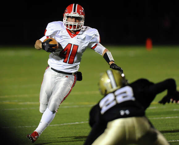 New Canaan's #41 Frank Cognetta, during boys football action against Trumbull in Trumbull, Conn. on Friday November 16, 2012. Photo: Christian Abraham / Connecticut Post