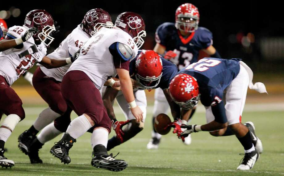Cy-Fair looses the ball in a fumble in the second half during the Class 5A Division I Playoff Football game at Berry Center on Friday, Nov. 16, 2012, in Houston. Alief Taylor wins  28-7 over the Cy-Fair Bobcats. Photo: Mayra Beltran, Houston Chronicle / © 2012 Houston Chronicle