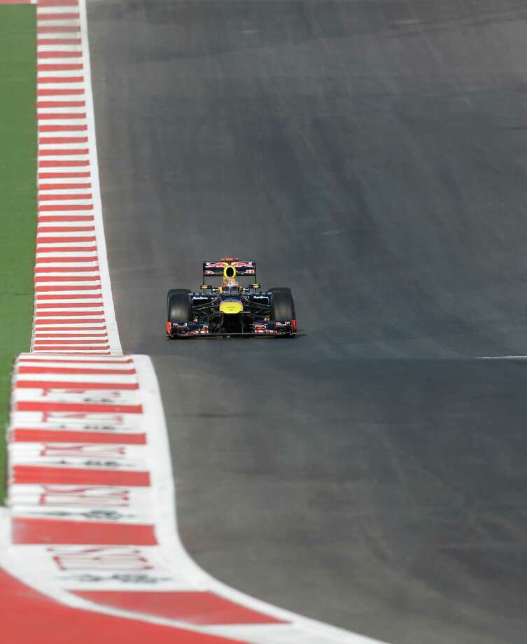 Red Bull driver Sebastian Vettel puts his car through its paces on the new $400 million track in Austin that is hosting this weekend's Formula One U.S. Grand Prix. Photo: Eric Gay, STF / AP
