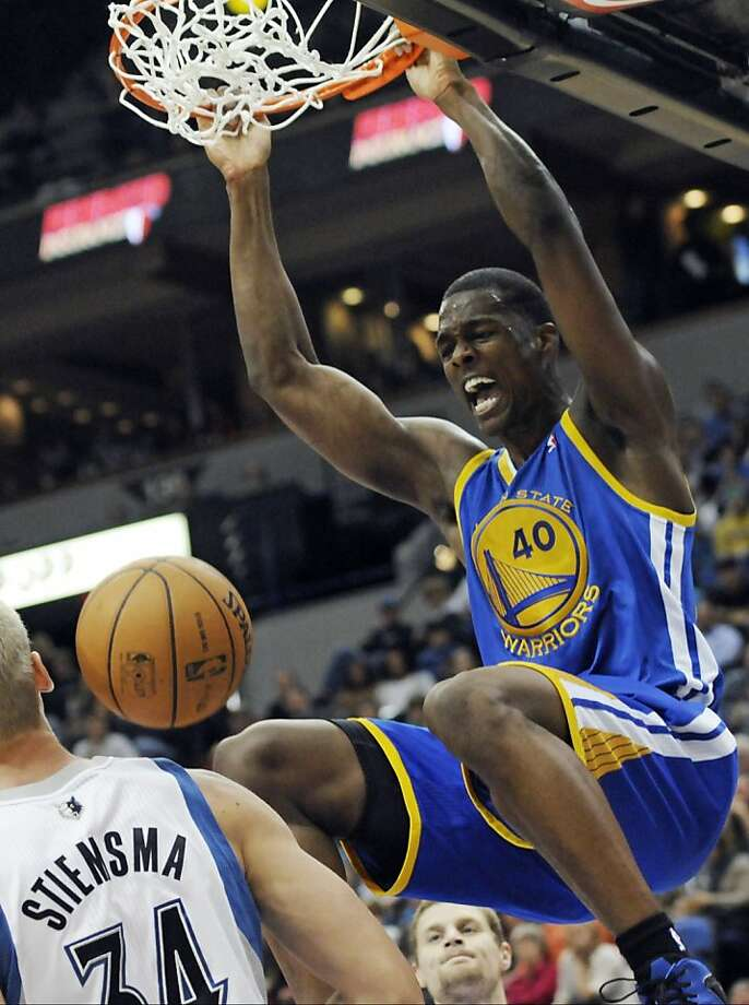 Rookie Harrison Barnes, dunking in the second half, finished with 18 points. Photo: Jim Mone, Associated Press