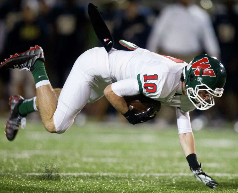 Woodlands wide receiver Houston Brown (10) brings down a pass reception for a first down against Klein Collins during the first quarter of a high school football game at Klein Memorial Stadium on Friday, Nov. 16, 2012, in Spring. Photo: J. Patric Schneider, For The Chronicle / © 2012 Houston Chronicle