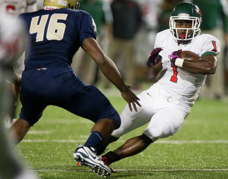 The Woodlands 35, Klein Collins 28Woodlands running back Patrick Carr (1) looks for running room past Klein Collins defensive lineman Isaiah Byrd (46) during the second quarter of a high school football game at Klein Memorial Stadium on Friday, Nov. 16, 2012, in Spring. Photo: J. Patric Schneider, For The Chronicle / © 2012 Houston Chronicle