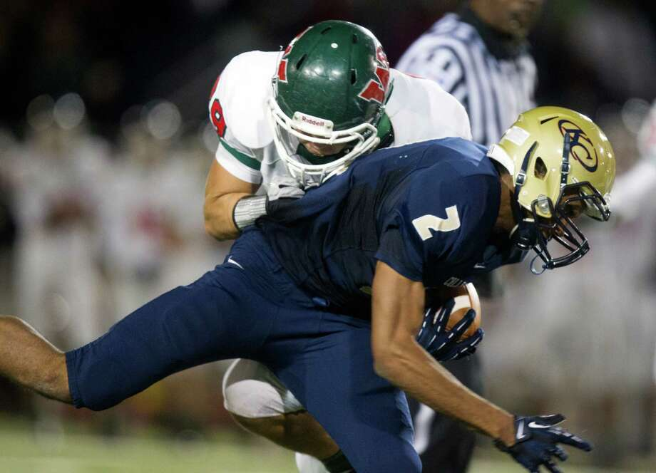Klein Collins wide receiver Jordan Thomas (2) brings down a pass reception against Woodlands linebacker Thomas Gilstrap (29) during the second quarter of a high school football game at Klein Memorial Stadium on Friday, Nov. 16, 2012, in Spring. Photo: J. Patric Schneider, For The Chronicle / © 2012 Houston Chronicle