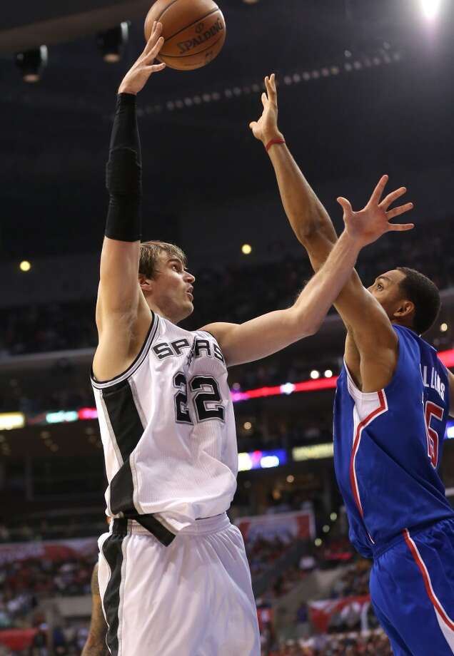 Tiago Splitter (22) of the Spurs shoots over Ryan Hollins (15) of the Clippers at Staples Center on Nov. 7, 2012 in Los Angeles.  The Clippers won 106-84.
