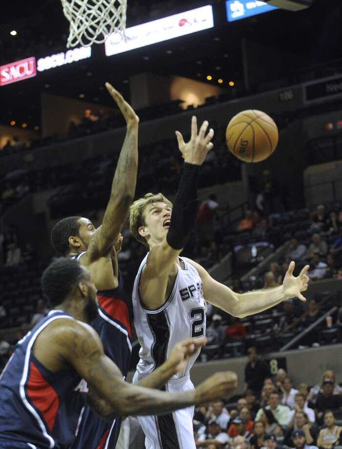 Tiago Splitter of the Spurs battles the Atlanta Hawks for the ball during preseason NBA action at the AT&T Center on Wednesday, Oct. 10, 2012.
