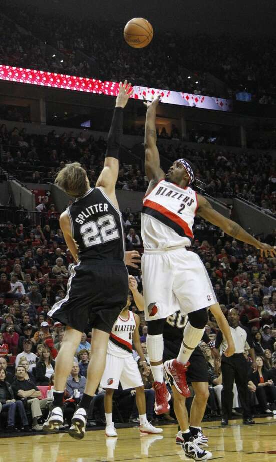 Trail Blazers guard Wesley Matthews (right) shoots over Spurs forward Tiago Splitter during the first half in Portland, Ore., Saturday, Nov. 10, 2012.