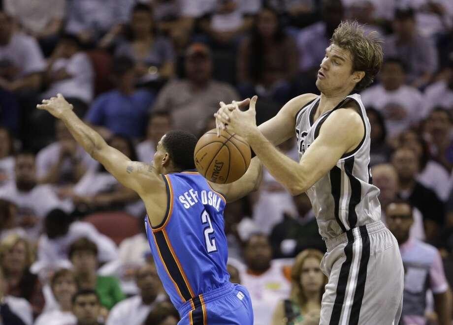 The Spurs' Tiago Splitter (right) and Thunder's Thabo Sefolosha during the second quarter, Thursday, Nov. 1, 2012, in San Antonio.
