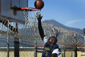 Allan McIntosh, an inmate on the San Quentin Warriors basketball team, warms up before a game against employees of the Golden State Warriors organization at San Quentin State Prison on Saturday, Sept. 22, 2012.