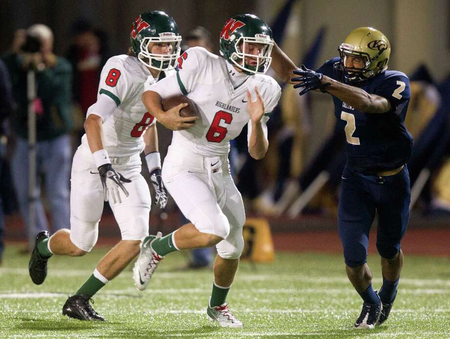 The Woodlands quarterback Blaine Gillespie (6) runs past Klein Collins defensive back Jordan Thomas (2) for a first down during the first quarter of a high school football game at Klein Memorial Stadium on Friday, Nov. 16, 2012, in Spring. Photo: J. Patric Schneider, For The Chronicle / © 2012 Houston Chronicle