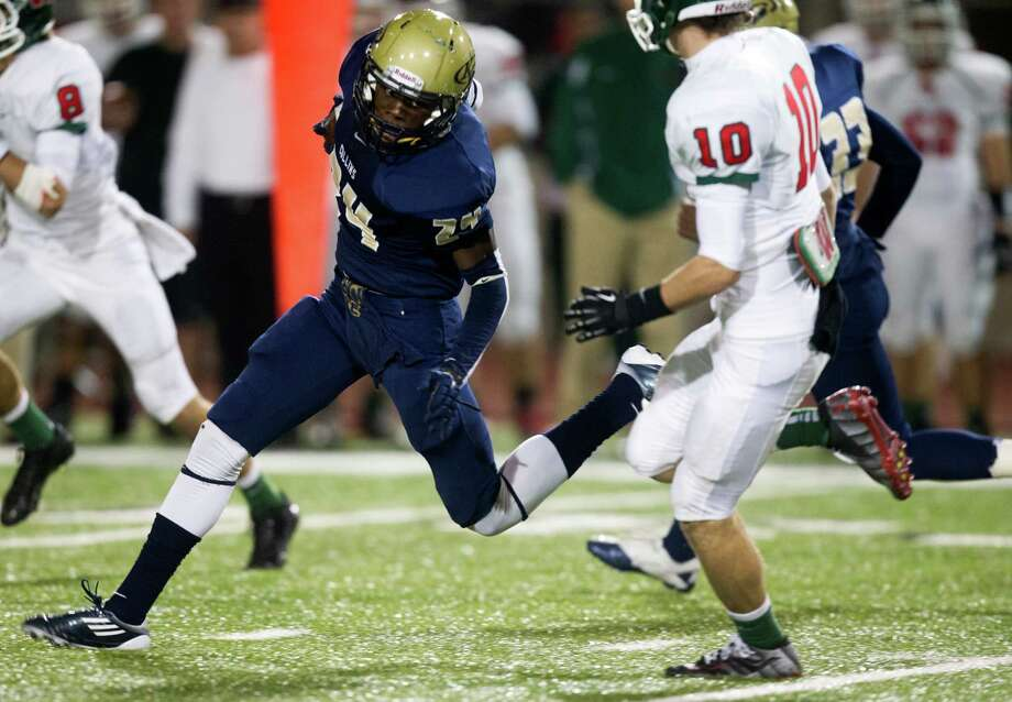 Klein Collins defensive back Kev'n Farmer (24) brings down an interception during the second quarter of a high school football game against the Woodlands at Klein Memorial Stadium on Friday, Nov. 16, 2012, in Spring. Photo: J. Patric Schneider, For The Chronicle / © 2012 Houston Chronicle