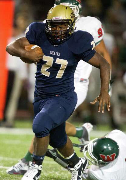 Klein Collins running back Jeremy Fair (27) breaks a tackle for a first down during the second quart