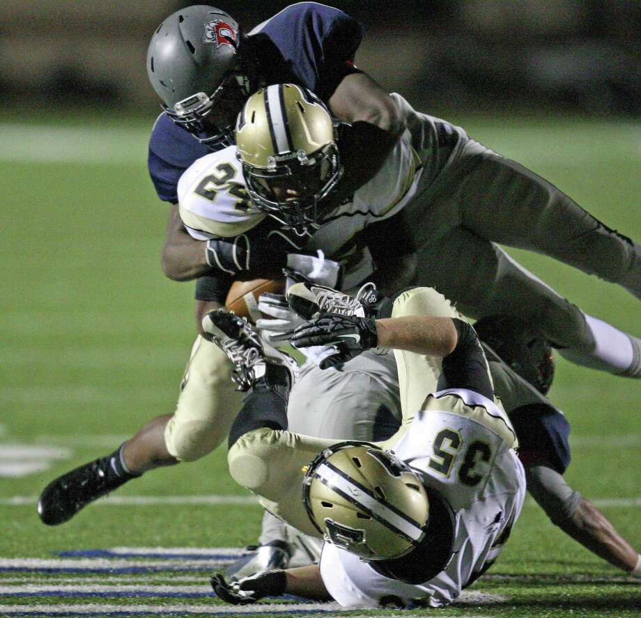 Foster's Kealan Blackshear (24) is tackled by Dawson's Brent Johnson during the first half of a Class 4A Division I high school football playoff game, Friday, November 16, 2012 at Galena Park ISD Stadium. Photo: Eric Christian Smith, For The Chronicle