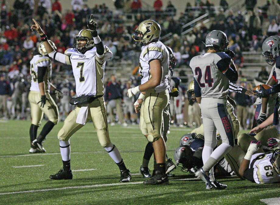 Foster quarterback Hasan Rizvi (7) celebrates his 1-yard touchdown run during the first half of a Class 4A Division I high school football playoff game against Dawson, Friday, November 16, 2012 at Galena Park ISD Stadium. Photo: Eric Christian Smith, For The Chronicle