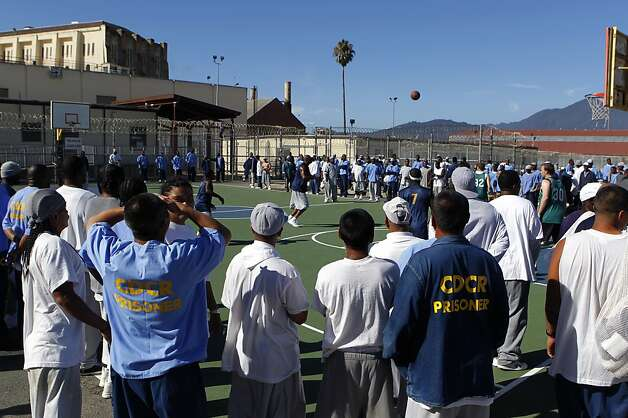 Inmates stood, sat in bleachers and camped on picnic tables to watch their team play Warriors staff members on a beautiful September day. Photo: Paul Chinn, The Chronicle