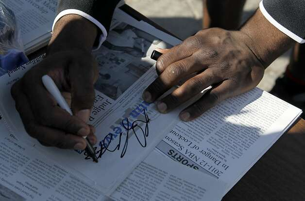 Golden State Warriors rookie Draymond Green autographs copies of the San Quentin News for inmate reporters covering a basketball game against the San Quentin Warriors at San Quentin State Prison on Saturday, Sept. 22, 2012. Green was networking with inmates while other employees of the organization played in the game. Photo: Paul Chinn, The Chronicle