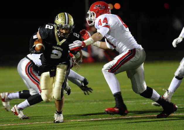 Trumbull's #2 Ryan Pearson can't avoid New Canaan's #44 Zachary Allen, during boys football action in Trumbull, Conn. on Friday November 16, 2012. Photo: Christian Abraham / Connecticut Post