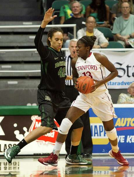 In a clash of local products, Baylor's Brittney Griner, a Nimitz graduate, defends Stanford's Chiney Ogwumike, a former Cy-Fair standout. Photo: Marco Garcia, FRE / FR132415 AP