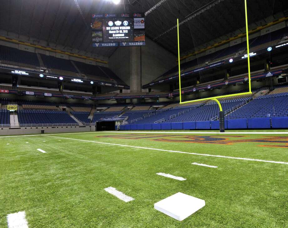 "First base will be near what is now the north end zone on the Alamodome football field when the Texas Rangers play the San Diego Padres during ""Big League Weekend,"" a two-game set on March 29-30, 2013. The right field fence will be only 280 feet away from home plate. Photo: Billy Calzada, Express-News / © 2012 San Antonio Express-News"