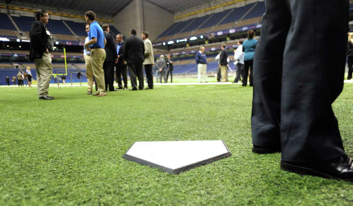 A temporary home plate is placed on the location of home plate when the San Diego Padres and the Texas Rangers play during