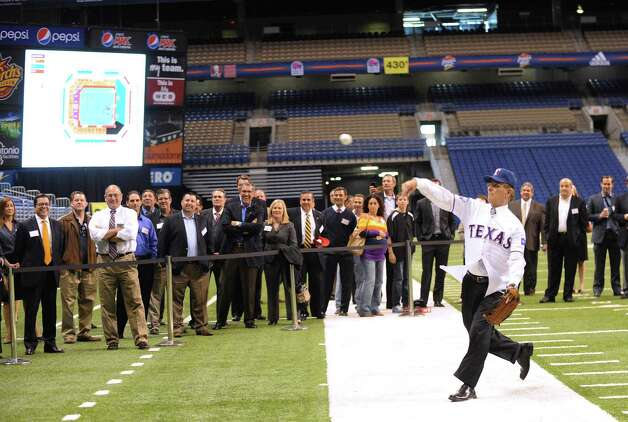 "County Judge Nelson Wolff throws the ""first pitch"" during a press conference on Friday, Nov. 16, 2012, to announce ""Big League Weekend,"" a two-game set between the Texas Rangers and the San Diego Padres to be played in the Alamodome on March 29-30, 2013. Photo: Billy Calzada, Express-News / © 2012 San Antonio Express-News"