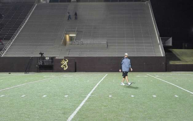 Vidor Head Coach Jeff Mathews takes a walk around the field prior to the start of the game. The Vidor High School Pirates football team played the Humble Summer Creek Bulldogs at 7 p.m. Friday night at Clyde Abshier Stadium in Deer Park Texas. This is a Class 4A Division I first round game.  At the half, Humble Summer Creek was ahead 24-14. Dave Ryan/The Enterprise Photo: Dave Ryan