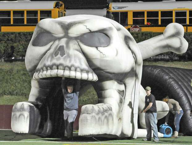Richard Oldbury, center, holds up the giant skull the team will run through when they enter the field. The Vidor High School Pirates football team played the Humble Summer Creek Bulldogs at 7 p.m. Friday night at Clyde Abshier Stadium in Deer Park Texas. This is a Class 4A Division I first round game.  At the half, Humble Summer Creek was ahead 24-14. Dave Ryan/The Enterprise Photo: Dave Ryan