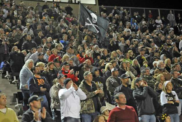 Vidor fans clap and wave flags as the team enter the field. The Vidor High School Pirates football team played the Humble Summer Creek Bulldogs at 7 p.m. Friday night at Clyde Abshier Stadium in Deer Park Texas. This is a Class 4A Division I first round game.  At the half, Humble Summer Creek was ahead 24-14. Dave Ryan/The Enterprise Photo: Dave Ryan