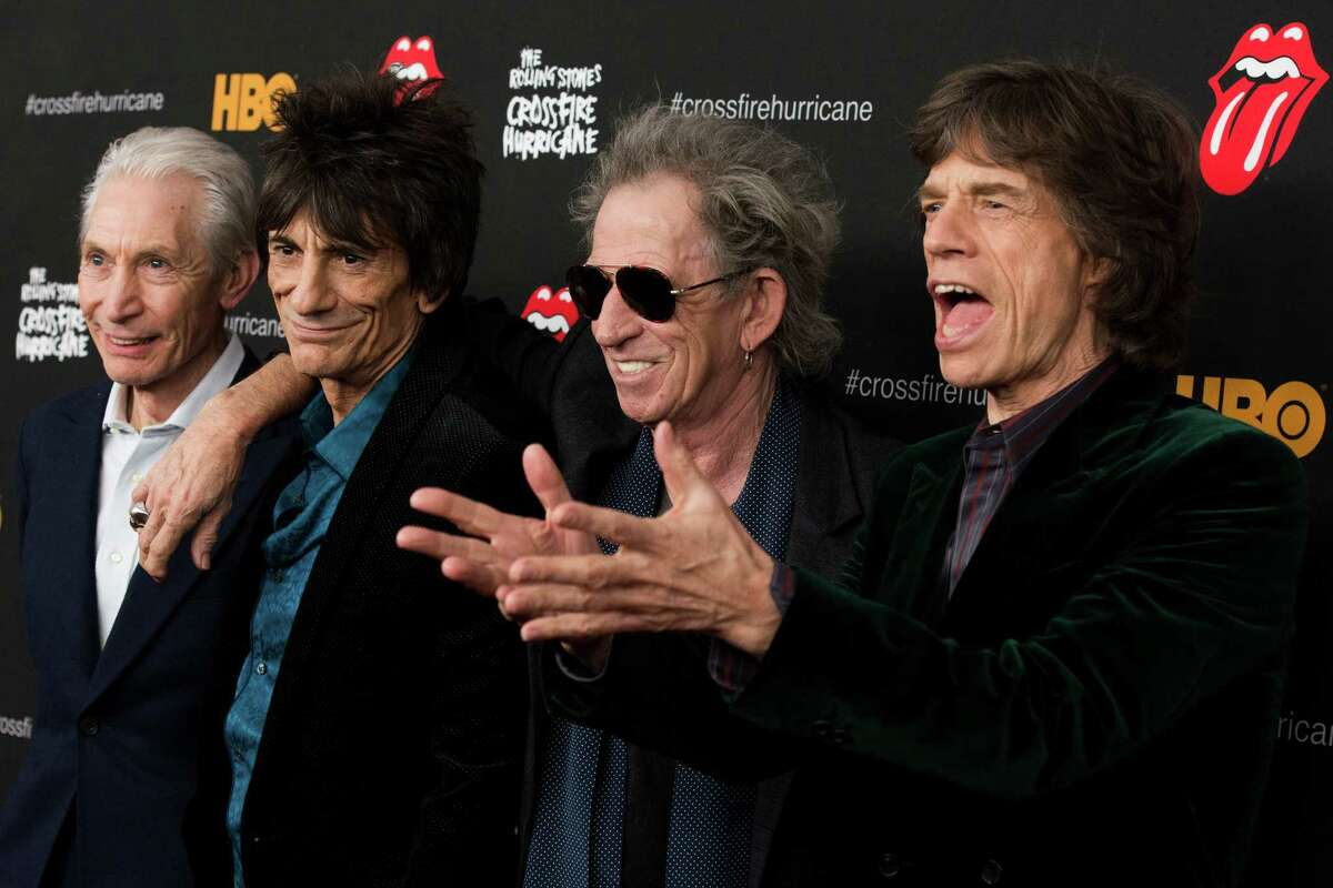 """Rolling Stones band members, from left, Charlie Watts, Ronnie Wood, Keith Richards and Mick Jagger attend """"The Rolling Stones Crossfire Hurricane"""" premiere on Tuesday, Nov. 13, 2012 in New York. Stamford-based WWE will produce the live pay-per-view show """"One More Shot"""" for the Stones' final show of their 50th-anniversary tour, performed at the Prudential Center, in Newark, N.J., on Dec. 15.(Photo by Charles Sykes/Invision/AP)"""
