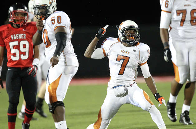 Madison's Marquis Warford (07) reacts after gaining a first down against Wagner in the Class 5A District I playoff game in the second half at Rutledge Stadium on Friday, Nov. 16, 2012. Madison moves on with a 37-21 win over Wagner. Photo: Kin Man Hui, San Antonio Express-News / © 2012 San Antonio Express-News