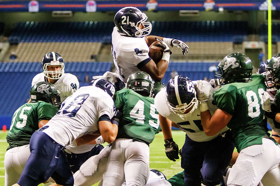 Smithson Valley's Lawrence Mattison (top) dives over the goal line for a one-yard touchdown, during the second quarter of their Class 5A Division II first round game with Reagan at the Alamodome on Nov 16, 2012.  Smithson Valley advanced with a 21-14 victory over the Rattlers.  MARVIN PFEIFFER/ mpfeiffer@express-news.net Photo: MARVIN PFEIFFER, Express-News / Express-News 2012