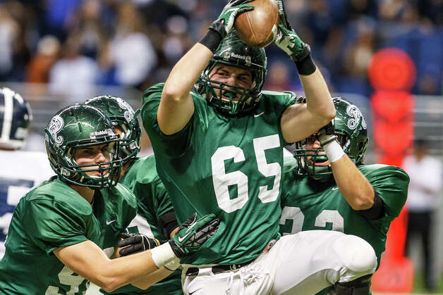 Reagan's Joe Lewis (center) celebrates a fumble recovery during their Class 5A Division II first round game with Smithson Valley at the Alamodome on Nov 16, 2012.  Smithson Valley won the game 21-14.  MARVIN PFEIFFER/ mpfeiffer@express-news.net Photo: MARVIN PFEIFFER, Express-News / Express-News 2012