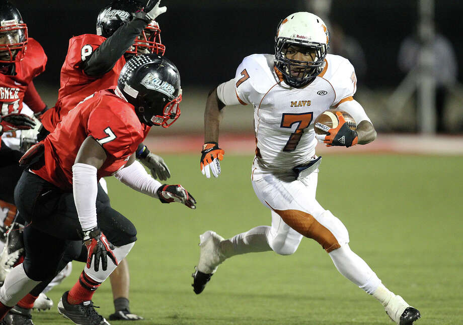 Madison's Marquis Warford (07) goes around Wagner defender Robert Gardner (07) looking for extra yardage in the Class 5A District I playoff game in the second half at Rutledge Stadium on Friday, Nov. 16, 2012. Madison moves on with a 37-21 win over Wagner. Photo: Kin Man Hui, Express-News / © 2012 San Antonio Express-News