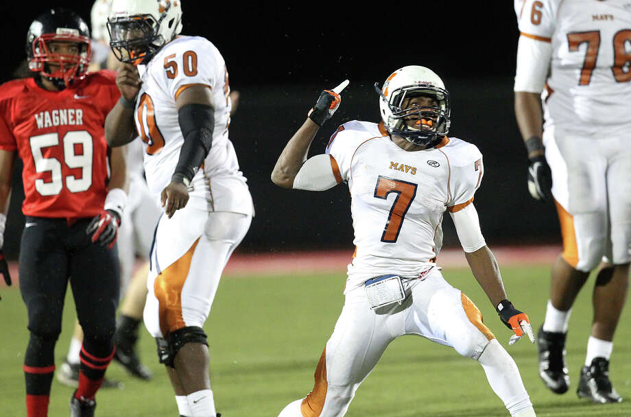 Madison's Marquis Warford (07) reacts after gaining a first down against Wagner in the Class 5A District I playoff game in the second half at Rutledge Stadium on Friday, Nov. 16, 2012. Madison moves on with a 37-21 win over Wagner. Photo: Kin Man Hui, Express-News / © 2012 San Antonio Express-News
