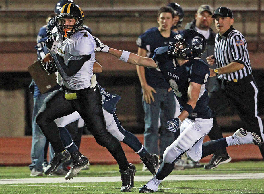 Receiver Dillon Gatian busts loose after a catch in the first half behind Liam Brennan as Champion hosts Brennan in 4A first round playoff action at Boerne Stadium on November 16, 2012. Photo: Tom Reel, Express-News / ©2012 San Antono Express-News