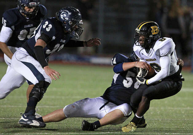 Bears running back Nathaniel Wells, Jr. squeezes out some yards in the first half as Champion hosts Brennan in 4A first round playoff action at Boerne Stadium on November 16, 2012. Photo: Tom Reel, Express-News / ©2012 San Antono Express-News