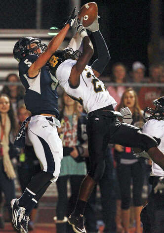 Bears defender Llandre Mitchell goes up to stop a pass intended for Michael Moloney in the end zone as Champion hosts Brennan in 4A first round playoff action at Boerne Stadium on November 16, 2012. Photo: Tom Reel, Express-News / ©2012 San Antono Express-News