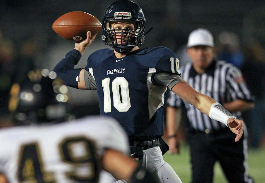 Charger quarterback Kyle Poeske throws in the firstg half as Champion hosts Brennan in 4A first round playoff action at Boerne Stadium on November 16, 2012. Photo: Tom Reel, Express-News / ©2012 San Antono Express-News