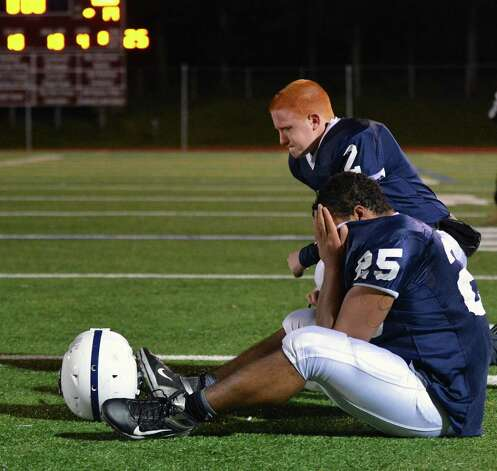 Rensselaer QB Steven Harwood, top, and #25 Seth Butler react to losing the Class D semifinal game to Tuckahoe at Dietz Stadium in Kingston Friday Nov. 16, 2012.  (John Carl D'Annibale / Times Union) Photo: John Carl D'Annibale / 00020085A