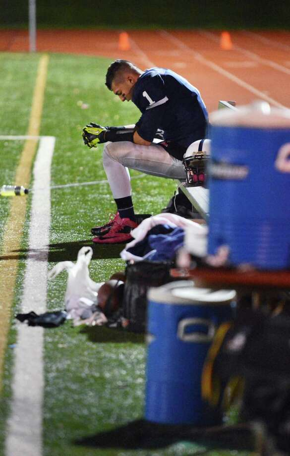 Rensselaer 's Tyler Oliver sits alone on the bench as the final seconds tick by during their loss to Tuckahoe High in the Class D semifinal game to  at Dietz Stadium in Kingston Friday Nov. 16, 2012.  (John Carl D'Annibale / Times Union) Photo: John Carl D'Annibale / 00020085A