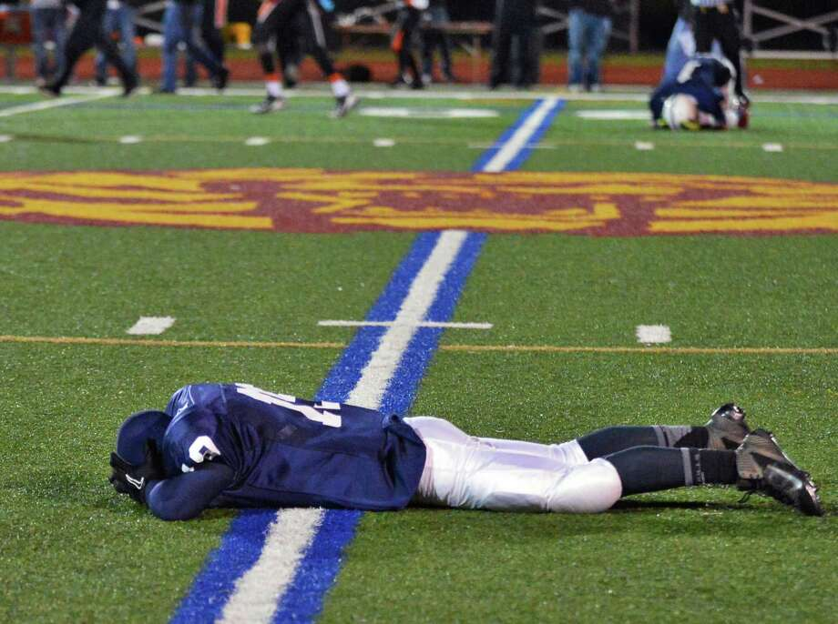Rensselaer's #19 Brandon Butler drops to the ground as they loose the Class D semifinal game to Tuckahoe at Dietz Stadium in Kingston Friday Nov. 16, 2012.  (John Carl D'Annibale / Times Union) Photo: John Carl D'Annibale / 00020085A