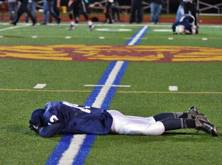 Rensselaer's #19 Brandon Butler drops to the ground as they loose the Class D semifinal game to Tuck